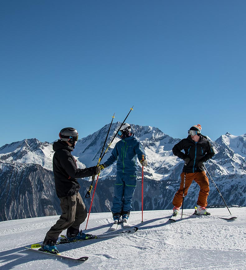 Private ski instructor giving lesson to 2 adults